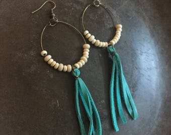 Boho cream colored wood beaded loop earrings with trendy turquoise leather tassel