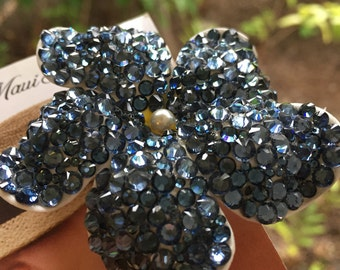 Mini megawatt Swarovski dark blue-colored  hair flower with swarovski pearl at center