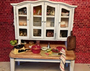Miniature kitchen dresser and table including all decoration