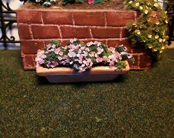 Pink flowers in a window box for dollhouses