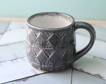 grey mug with triangle pattern