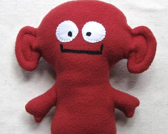 Plush monster, soft alien fantasy creature in brick red fleece, 11.5 inches