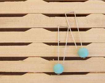 Delicate silver wire drop earrings with 10mm solid cool mint resin bead.