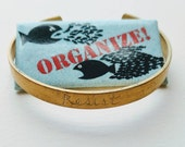 Resist cuff. 100% to charity.