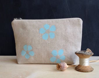 linen zip pouch hand printed with duck egg blue petal