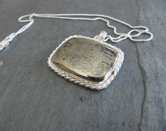 Apache Gold and Serling Silver Pendant