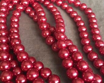 "Round Raspberry Glass Pearls - 15"" strand"