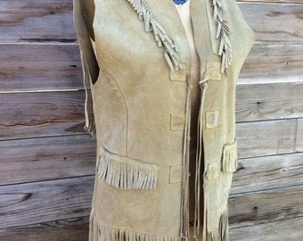 1960's tan suede vest with feinge detail and pockets size: medium