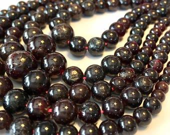 Garnet graduated round gemstone bead strand