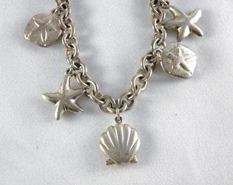 Silver seashell charm bracelet, starfish, sand dollar, sea shell charm, gift for girls, gift for women, teen gift, nautical bracelet