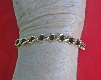 """AVON signed Vintage gold tone 6.75"""" bracelet with black beads in great condition, appears unworn"""