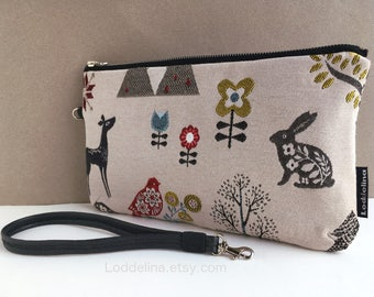 Large WRISTLET clutch in woodland jacquard with detachable wrist strap