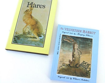 two miniature bunny books.   hares.   the velveteen rabbit.      miniature books.  collection.   tiny library.