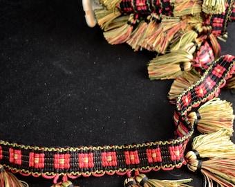 23192 Rogue Black Green Gold Red Tassel Trim