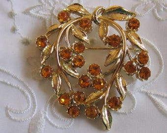 Vintage Gold Tone Leaf Brooch with Gold Faceted Rhinestones