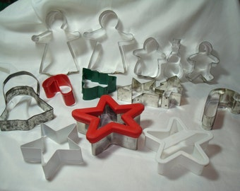 Fourteen Metal and Plastic Christmas Holiday Cookie Cutters.