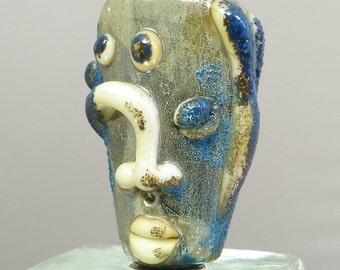 Ancients series - silvered mask amulet assymetric face focal