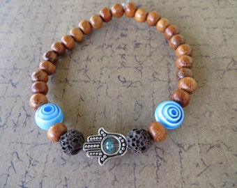 Essential Oil Diffusing Aromatherapy Stretch Bracelet With Silver Hamsa Brown Lava Stone Blue Glass And Wood
