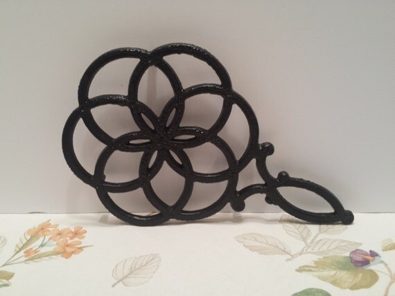 Enameled Cast Iron Trivet with Handle -  Celtic Knot Design - Vintage Black Iron Footed Trivet - Kitchen Decor - Counter or Table Protector