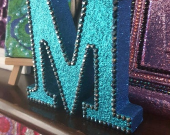 Letter M, turquoise teal glitter with black rhinestones, glittered, initial, name, freestanding, sparkly