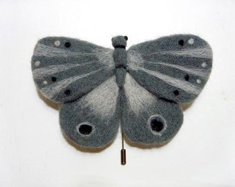 A felt brooch -  misty moth