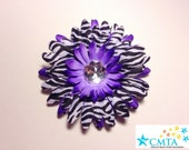 One purple and zebra hair flower with a rhinestone. Portion of sale goes to charity.