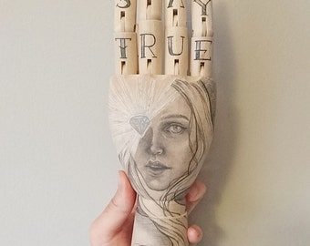 Stay True, 25cm wooden artist hand, hand drawn