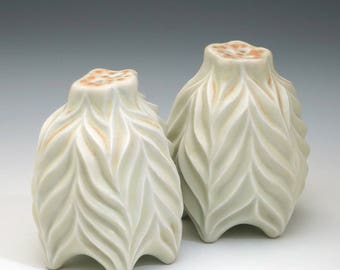 Porcelain salt and pepper shaker set in pale yellow & peach glazes