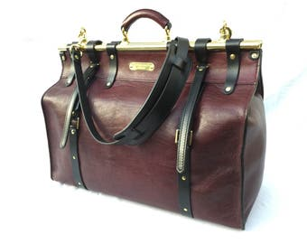 Weekender Travel Bag, in Mulberry coloured Leather with Brass Hardware.