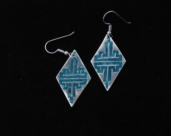 Diamond shaped silver dangle earrings highlighted with teal faux enameling