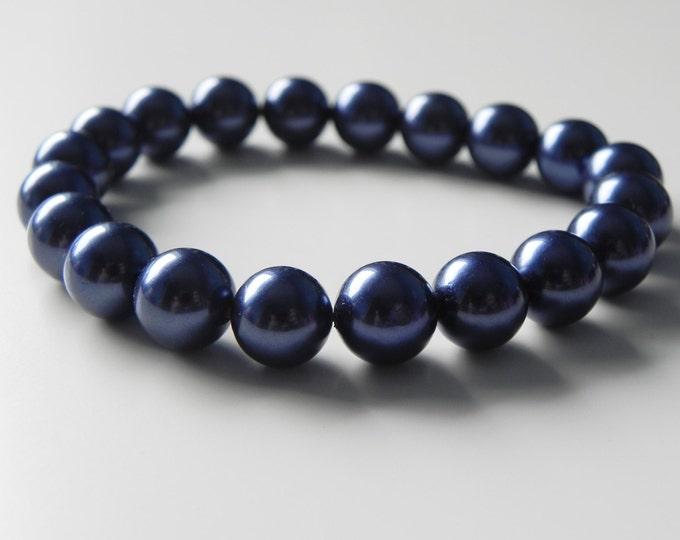 "Prussian blue shell pearl stretch bracelet. Approx 7.5"""