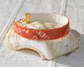 boho narrow cuff silk bracelet, textile bracelet, upcycled jewellery, silk jewellery, orange and white, artisan jewellery