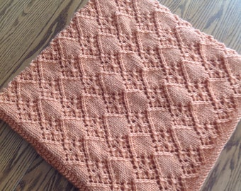 New hand knit diamond pattern afghan in peach