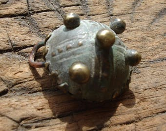 Brass Moroccan  very small tiny tarnished hand engraved  round pendant with points and dots