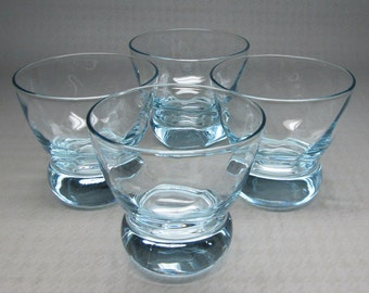 4 eva zeisel glasses , these are blue and have a twist Federal glass , prestige pattern