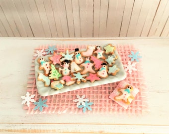 Miniature Christmas Sugar Cookies Decorated In Pretty Pastels