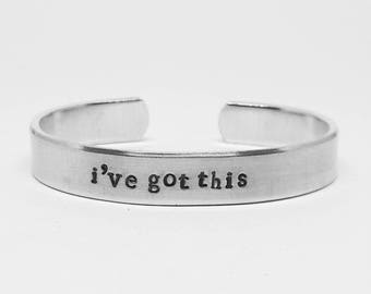 I've got this: hand stamped aluminum reminder cuff bracelet