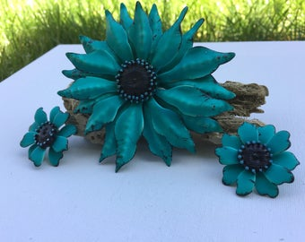 Bold aqua, blue flower brooch with matching clip earrings.
