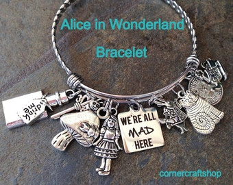 ALICE IN WONDERLAND fan  Stainless Steel Bangle Bracelet w/ 9 Charms We're all Mad Here, drink me, key, cat, tea cup, rabbit,  caterpillar