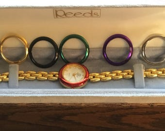 Faux new vintage Gucci watch with changeable colored face bands