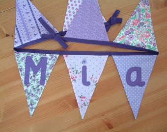 Personalised bunting, name banner. Purple, lilac. Appliques available, hearts, butterflies. Fabric flags. Florals. Made to order.