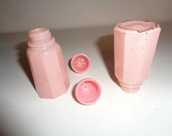 Vintage Collectable SALT AND PEPPER Shakers in Pink Milk Glass and pink bakelite plastic tops with wonderful well developed patina