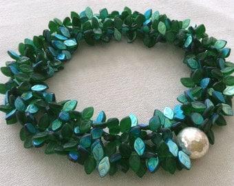 Emerald  leaf necklace . long statement necklace