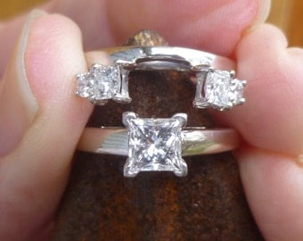 Over a Carat of LEO diamonds set in platinum heads and white gold  All paperwork included  SI I  Square Modified Cut .