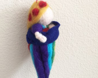 Baby wearing Rainbow Goddess needle felted sculpture