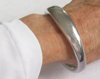 "57.6 Gram Sterling Silver Mexican Bangle Bracelet is a Heavy Hollow Piece with 3"" Diameter Between All Outer Edges..."