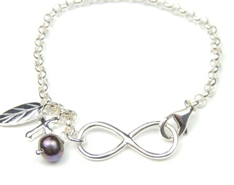 Infinity Bracelet in Sterling Silver with Cross, Feather and Fresh Water Pearl Charms,
