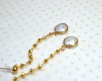 Elegant white coin pearl earrings Delicate linear earrings Long pearl dangle earrings Gold pyrite bead rosary chain Elegant gemstone jewelry