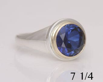 Blue saphire ring, size 7 1/4, sterling silver and 14k yellow gold, #809.