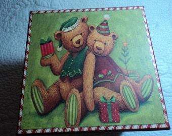 Two teddy bears on a square cardboard box